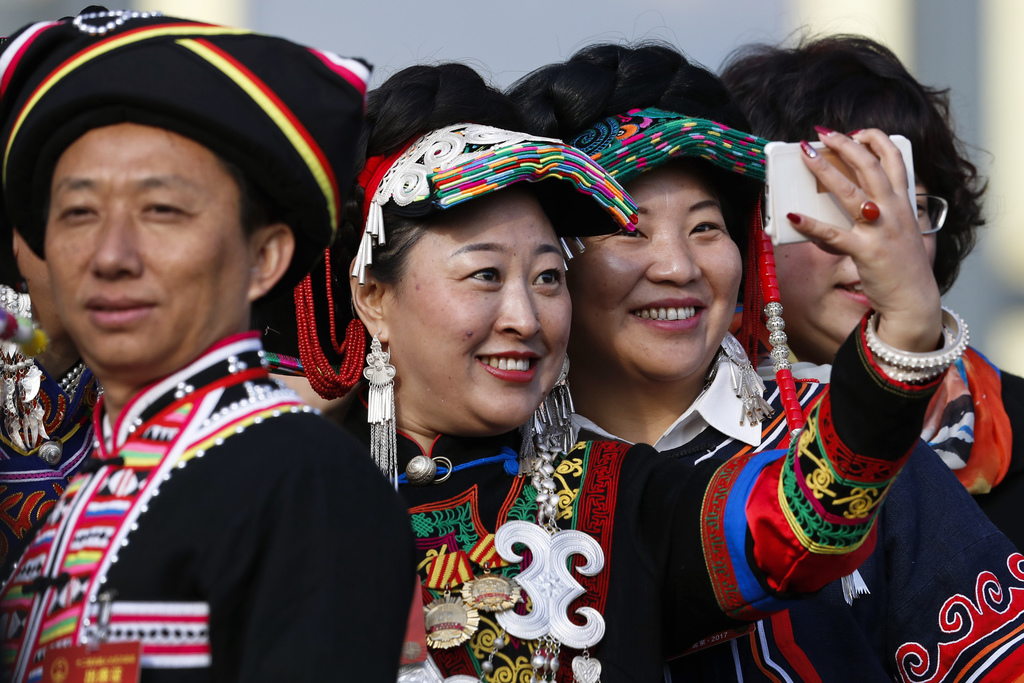 Minority delegates take a selfie as they arrive outside the Great Hall of the People to attend the opening session of the annual Nation...