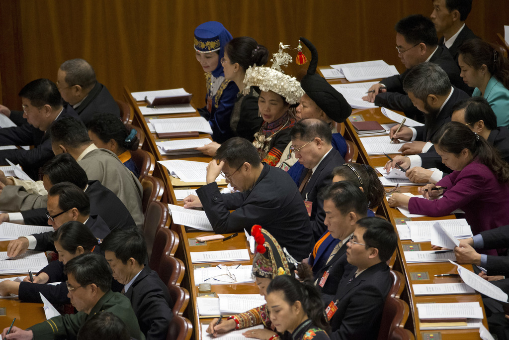 Delegates attend the opening session of the annual National People's Congress in Beijing's Great Hall of the People, Sunday, March 5, 2...
