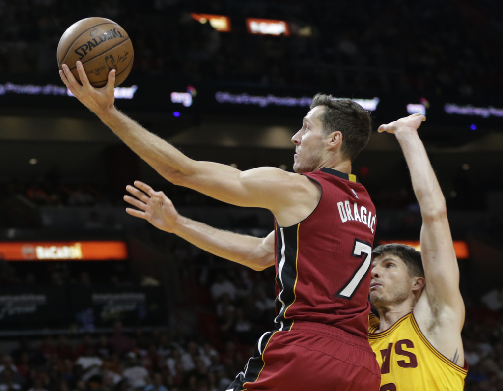 Miami Heat's Goran Dragic (7) drives to the basket as Cleveland Cavaliers' Kyle Korver defends during the second half of an NBA basketb...