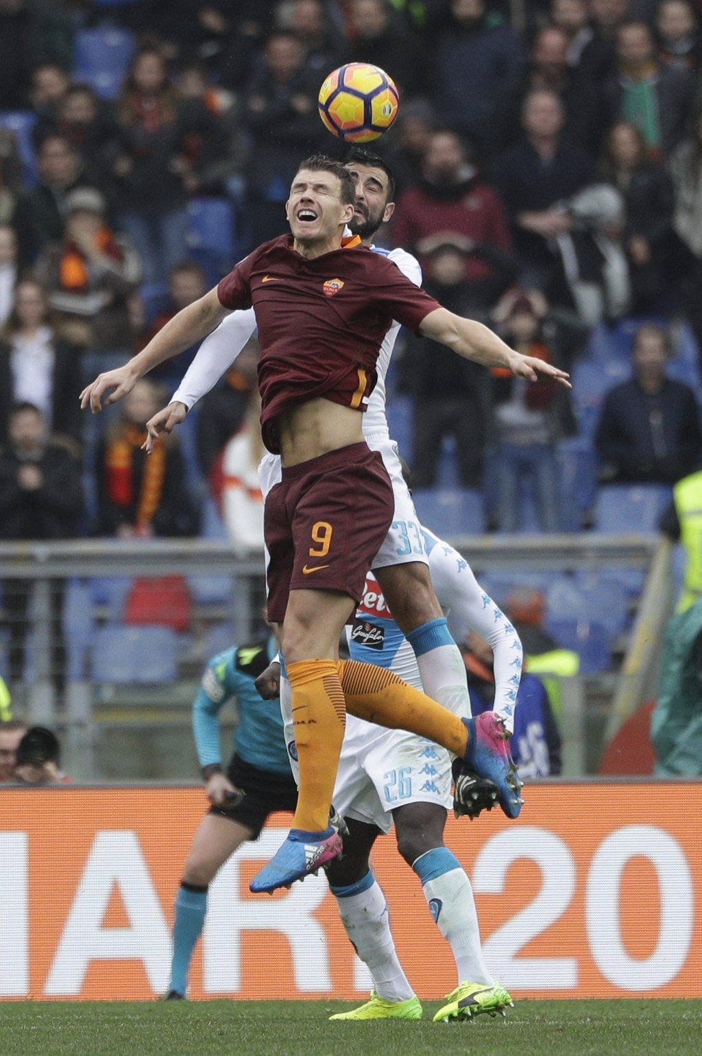 Roma's Edin Dzeko, foreground, and Napoli's Raul Albiol jump for the ball during a Serie A soccer match between Roma and Napoli, at the...
