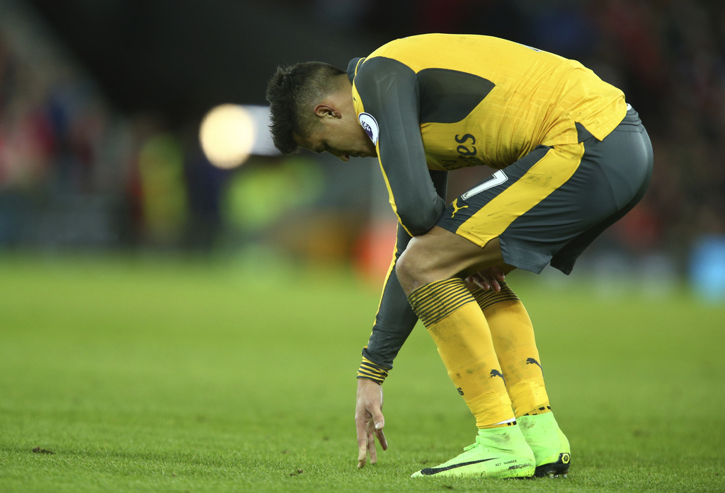 Arsenal's Alexis Sanchez looks down just after the final whistle following the English Premier League soccer match between Liverpool an...