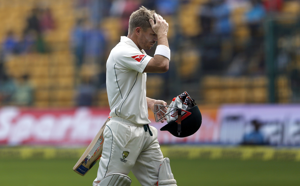 Australia's David Warner leaves the ground after being dismissed during the second day of their second test cricket match against India...