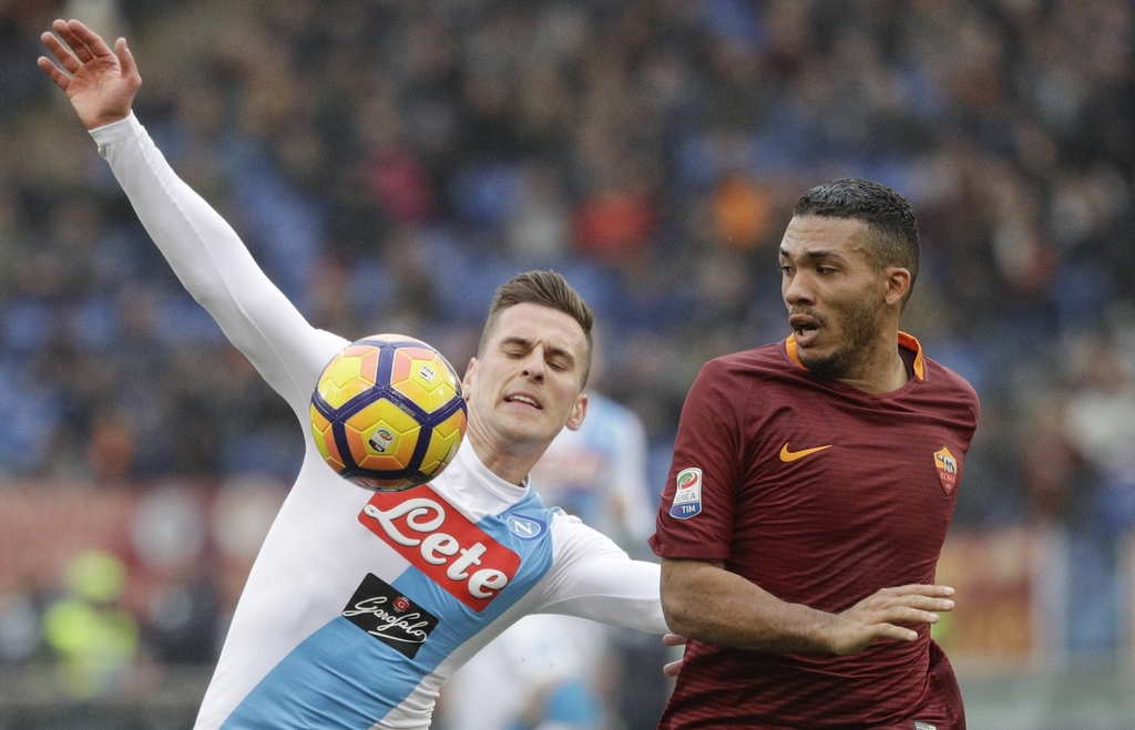 Napoli's Marko Rog, left, and Roma's Juan Jesus go for the ball during a Serie A soccer match, at the Rome Olympic stadium, Saturday, M...