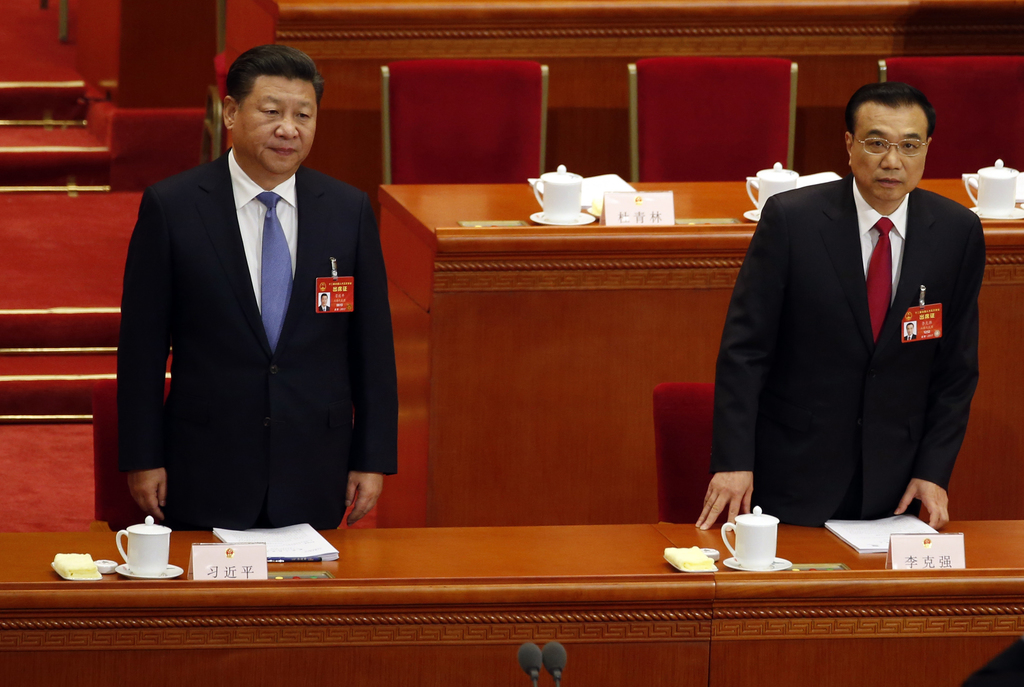 Chinese President Xi Jinping, left, and Chinese Premier Li Keqiang arrive for the opening session of the annual National People's Congr...