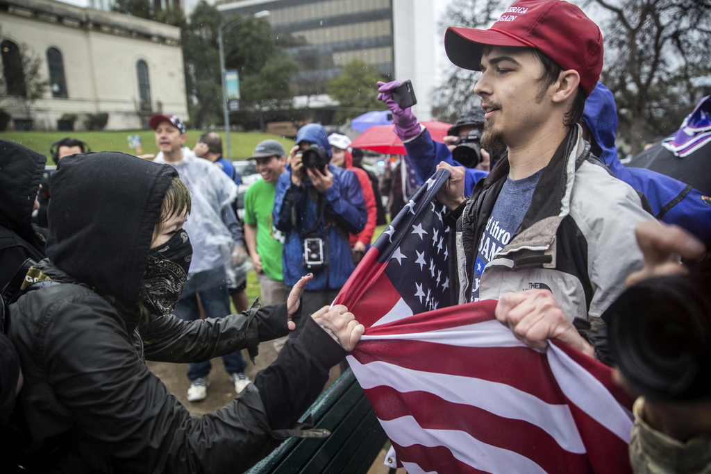 """Counter-protesters clash with supporters of President Donald Trump at Wooldridge Park in Austin, Texas, during a """"March 4 Trump,"""" rally..."""