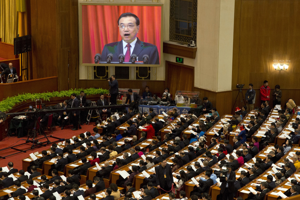 Chinese Premier Li Keqiang is displayed on a huge screen as he delivers a work report at the opening session of the annual National Peo...