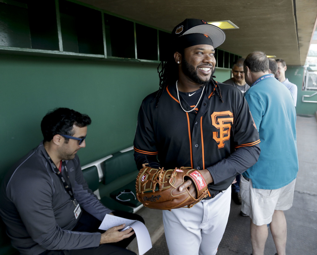 San Francisco Giants starting pitcher Johnny Cueto talks to the media before a spring training baseball game in Scottsdale, Ariz., Satu...