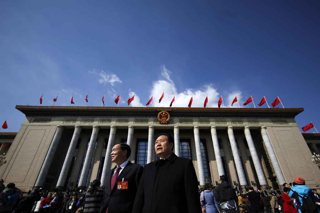 Delegates leave the Great Hall of the People after attending the opening session of the annual National People's Congress in Beijing, S...