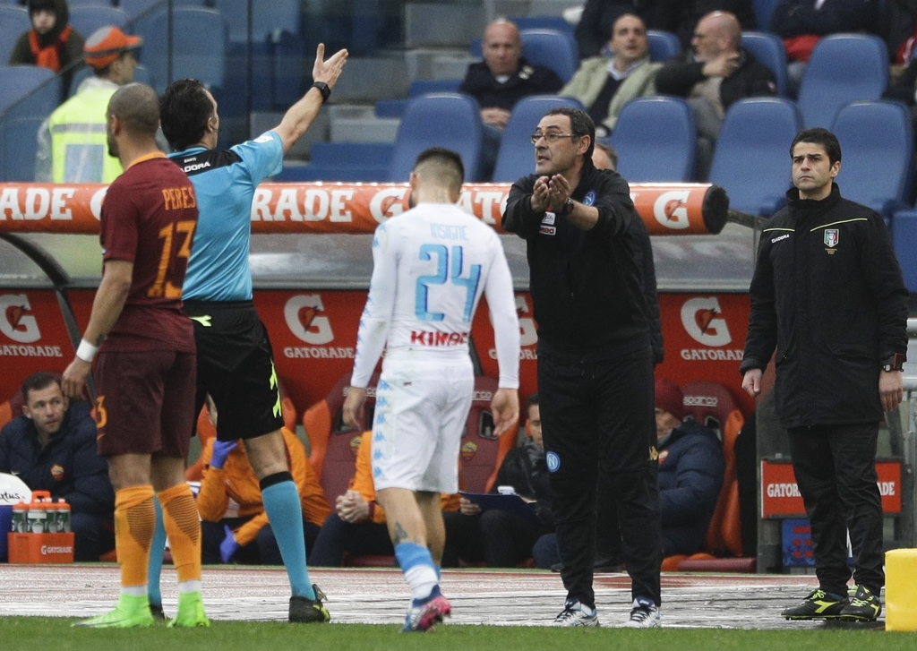 Referee Luca Banti, left, sends off Napoli coach Maurizio Sarri during a Serie A soccer match between Roma and Napoli, at the Rome Olym...