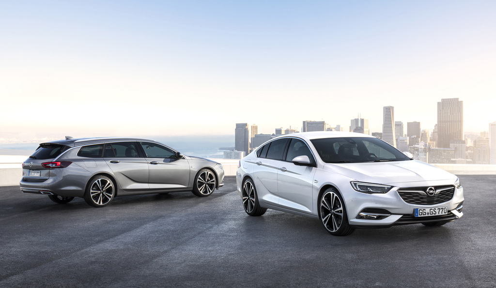 This undated image provided by car manufacturer Opel AG, shows a Opel Insignia Grand Sport, right, and the Insignia Sports Tourer stati...