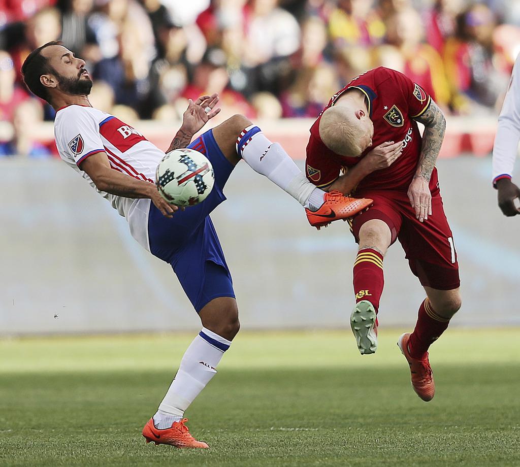 Toronto FC midfielder Victor Vazquez (7) kicks up just as Real Salt Lake midfielder Luke Mulholland (19) tries to head the ball during ...