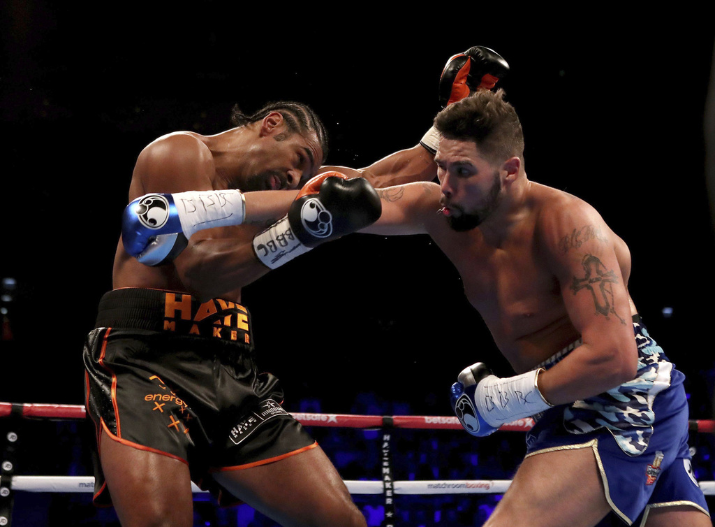Tony Bellew, right, and David Haye in action during the heavyweight contest in London, Saturday March 4, 2017. (Nick Potts/PA via AP)  ...