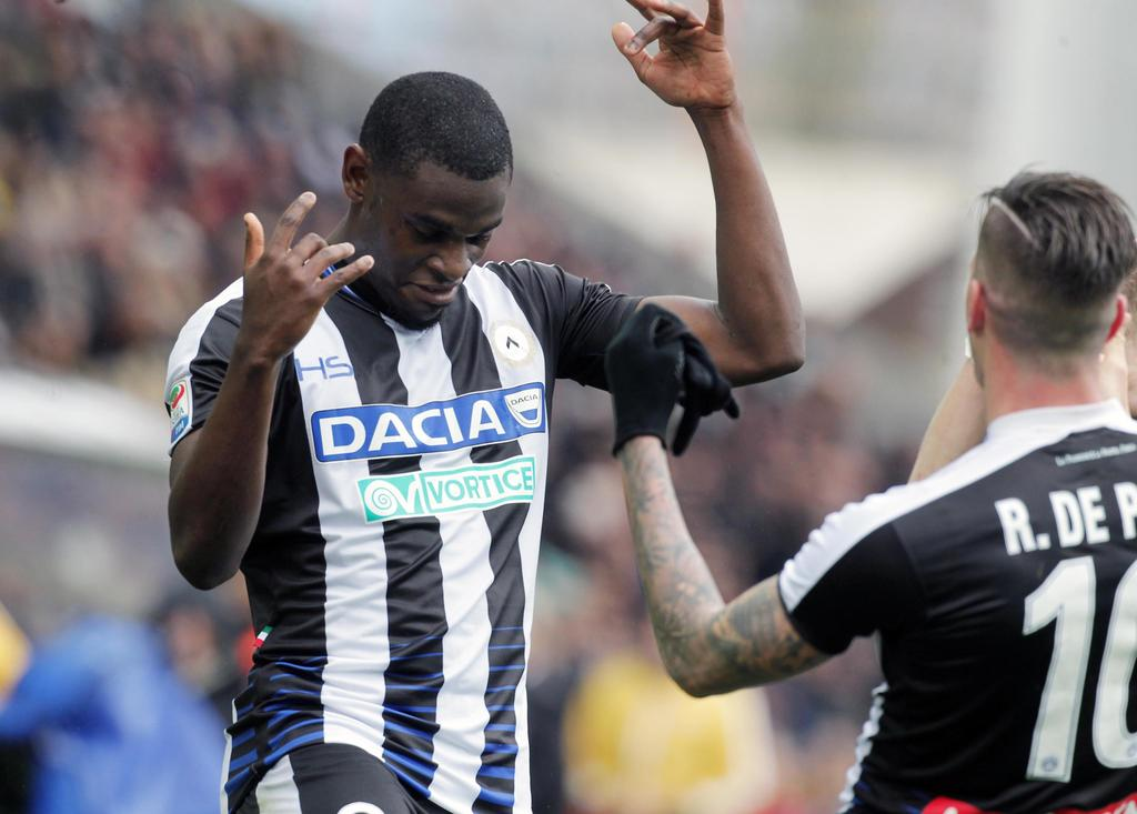 Udinese's Duvan Zapata, left, celebrates after scoring during a Serie A soccer match between Udinese and Juventus, at the Friuli stadiu...