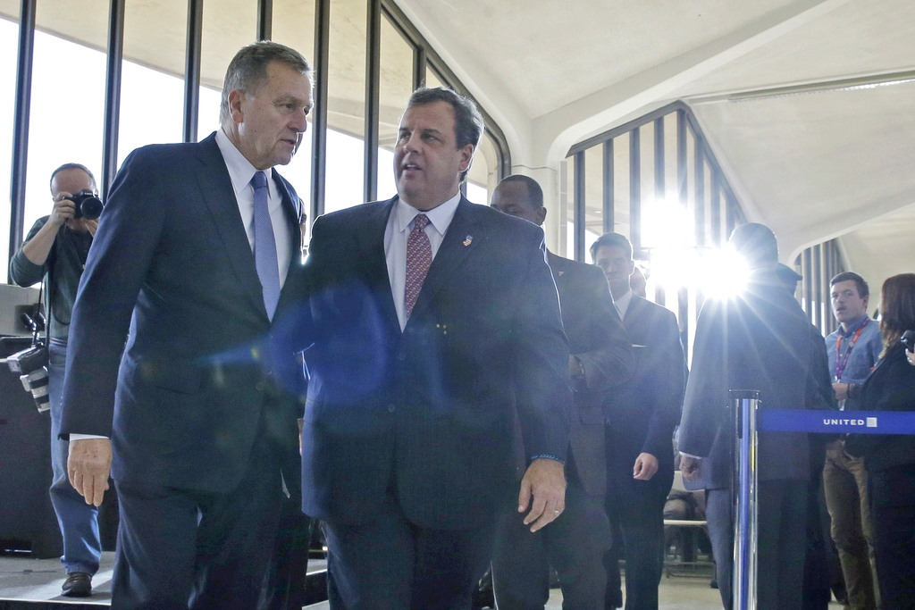 FILE – In this Nov. 14, 2013, file photo, New Jersey Gov. Chris Christie, center, walks with David Samson, left, chairman of The Port A...