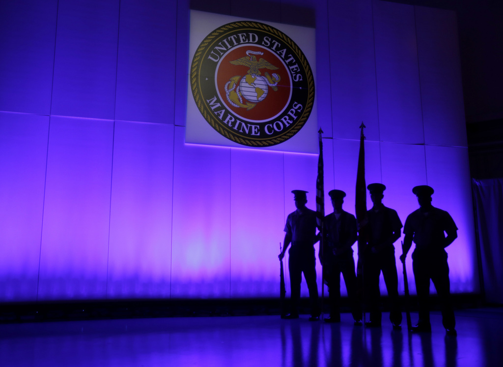 FILE- In this May 5, 2014, file photo, a U.S. Marine Corps Color Guard stands under a Marine Corps emblem in Jupiter, Fla. The Defense ...