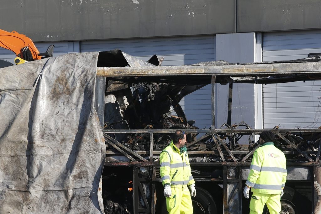 FILE - This  Jan. 21, 2017 file photo shows  the gutted remains of the bus that crashed along the A4 highway in Verona, Italy, Hungaria...
