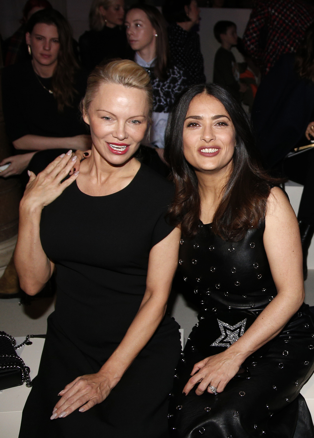 Pamela Andersonn, left, and Salma Hayek attend Stella McCartney's Fall-Winter 2017/2018 ready-to-wear collection presented in Paris, Mo...