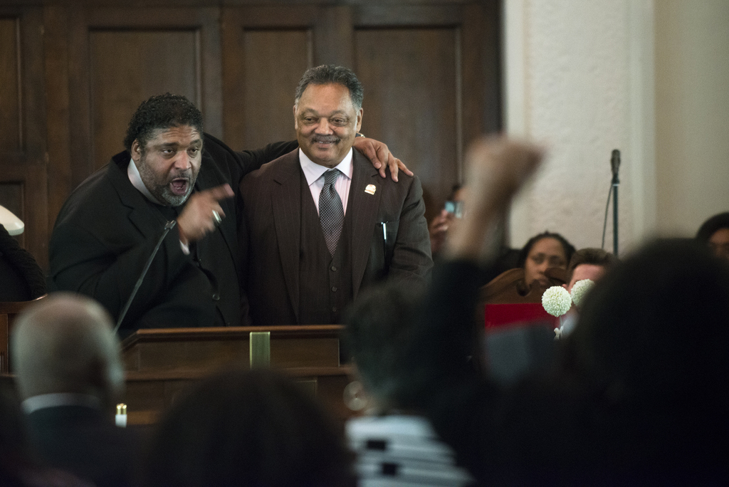 The Rev. Jesse Jackson, right, stands with the Rev. William Barber, North Carolina NAACP president, during a service at Brown Chapel Af...