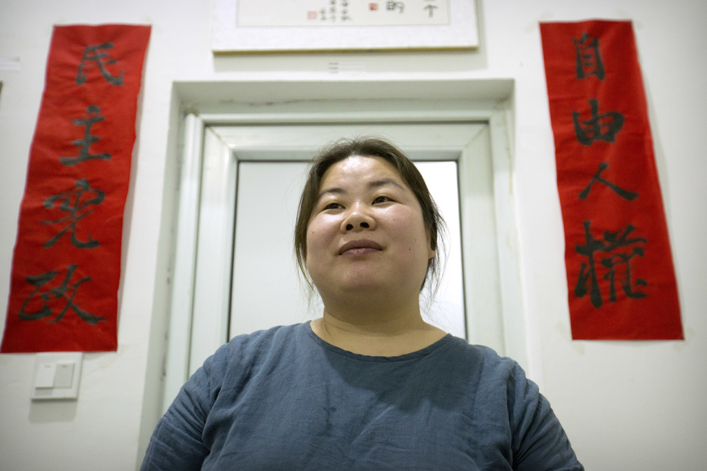 In this Monday, Feb. 27, 2017 photo, Ye Haiyan poses for a photo on in her art studio on the outskirts of Beijing. Ye has resorted to a...