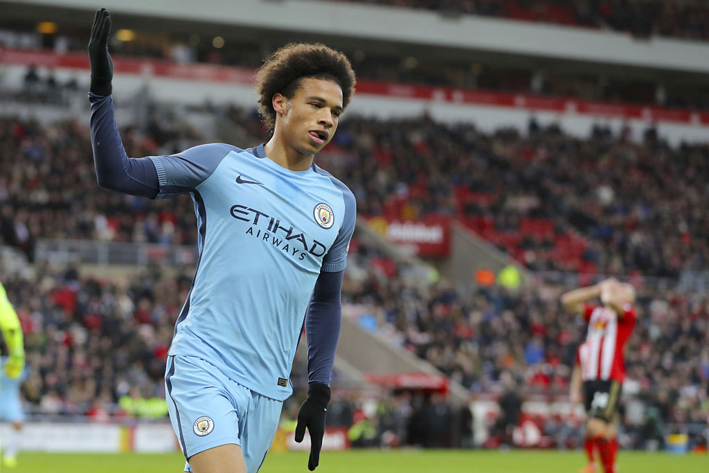 Manchester City's Leroy Sane celebrates scoring his side's second goal of the game during the Premier League soccer match between Sunde...