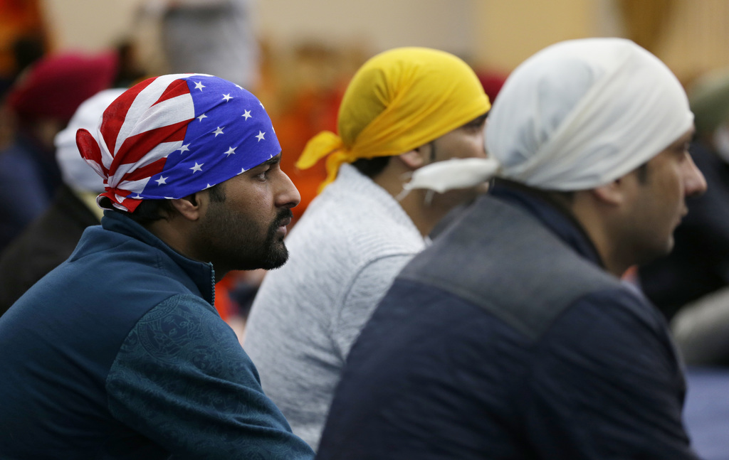 A man wears a head covering with the stars and stripes of a U.S. flag as he attends Sunday services at the Gurudwara Singh Sabha of Was...
