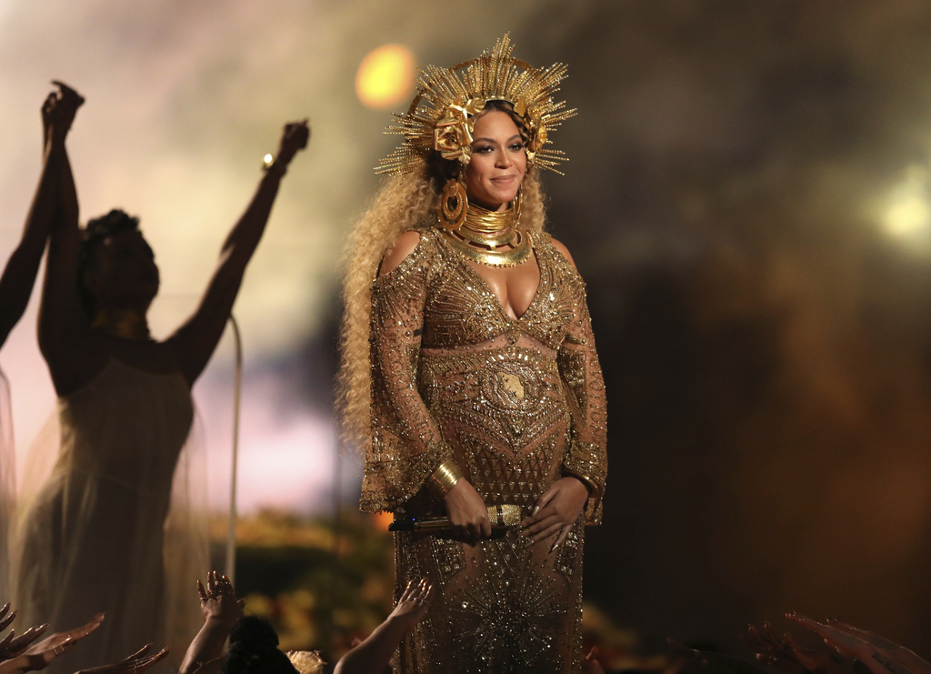 FILE - This Feb. 12, 2017 file photo shows Beyonce performing at the 59th annual Grammy Awards in Los Angeles. Beyonce and Jay Z, along...