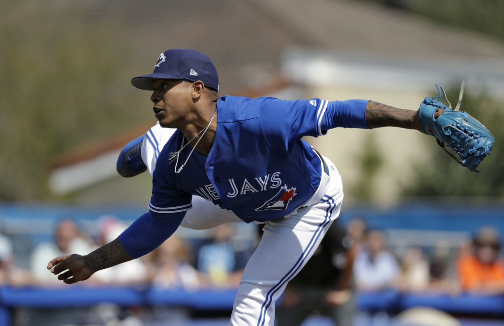 Toronto Blue Jays starting pitcher Marcus Stroman follows through on a pitch to the Tampa Bay Rays during the third inning of a spring ...