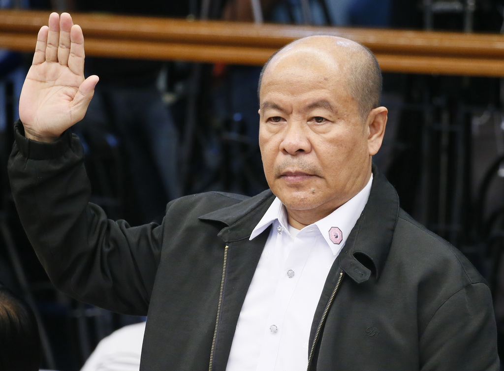 CORRECT FIRST NAME TO ARTURO - Retired police officer Arturo Lascanas takes his oath as he testifies before a Senate inquiry Monday, Ma...