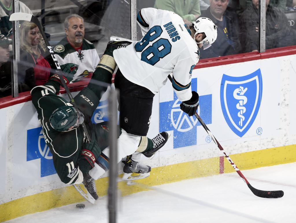 San Jose Sharks defenseman Brent Burns (88) checks Minnesota Wild left wing Zach Parise (11) during the first period of an NHL hockey g...