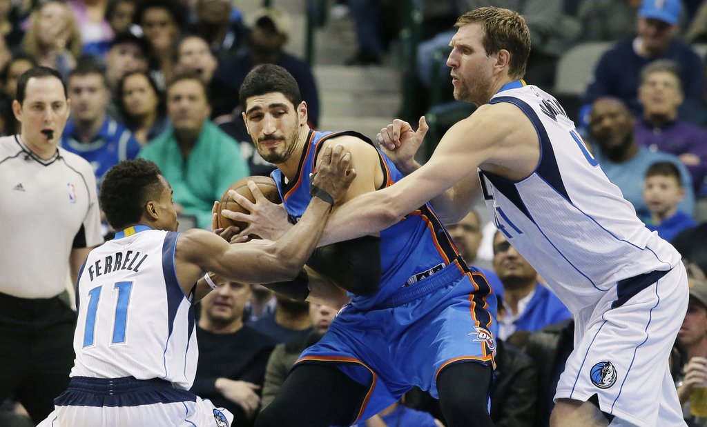Oklahoma City Thunder center Enes Kanter, center, is double teamed by Dallas Mavericks forward Dirk Nowitzki (41), right, of Germany, a...