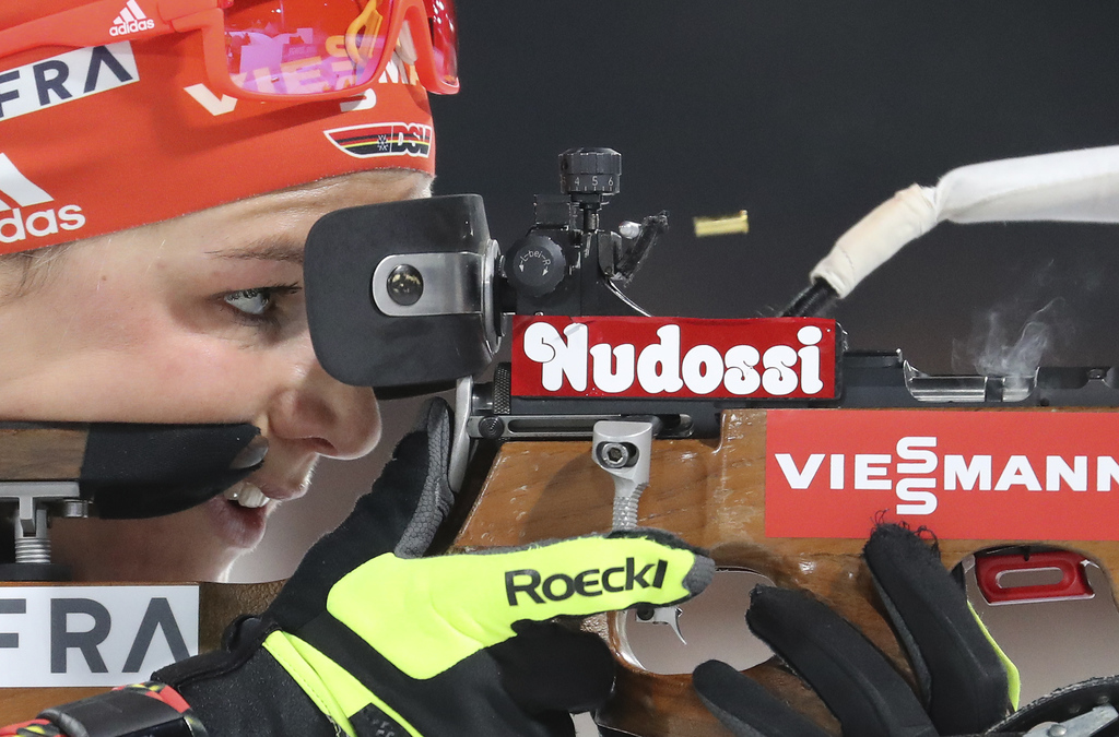 In this Thursday, March 2, 2017, photo, Germany's Denise Herrmann shoots as she warms up prior to the women's Biathlon 7.5 km sprint co...