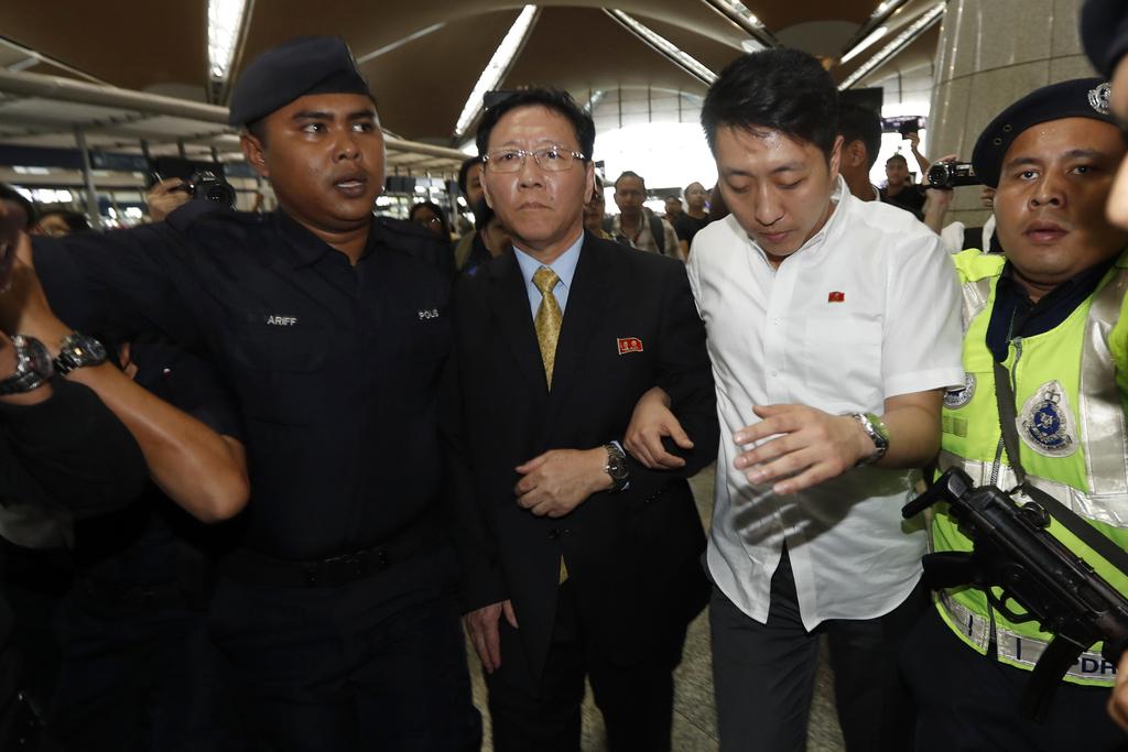 North Korean Ambassador to Malaysia Kang Chol, center, arrives at Kuala Lumpur International Airport in Sepang, Malaysia, Monday, March...