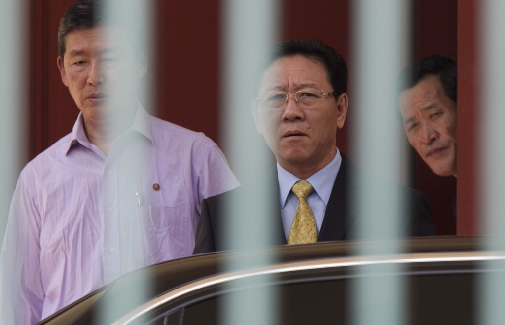 North Korean Ambassador to Malaysia Kang Chol, center, prepares to get on a car at the embassy in Kuala Lumpur, Malaysia, Monday, March...