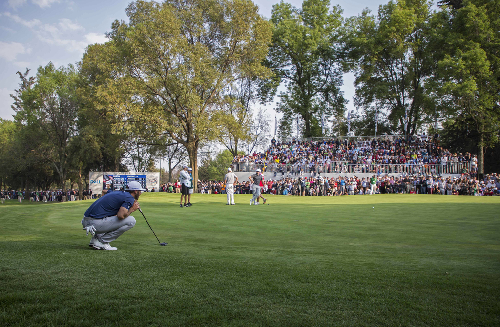 Dustin Johnson, of the United States, watches the ball at the 18th green during the Mexico Championship at Chapultepec Golf Club in Mex...