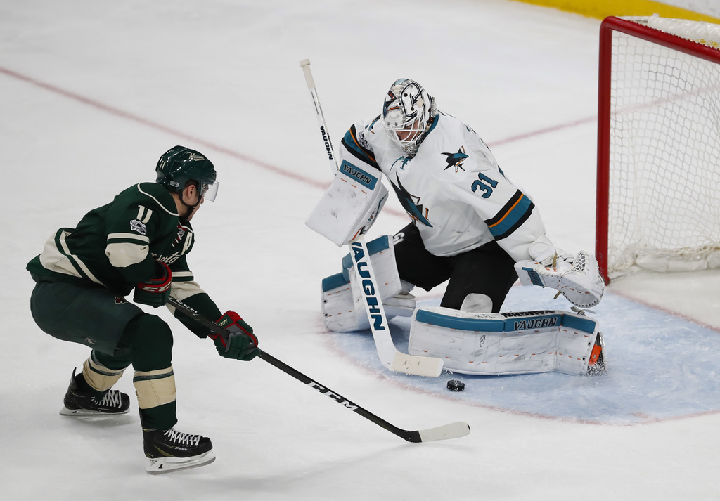 San Jose Sharks goalie Martin Jones (31) makes a pad save on a breakaway shot by Minnesota Wild left wing Zach Parise (11) in the secon...