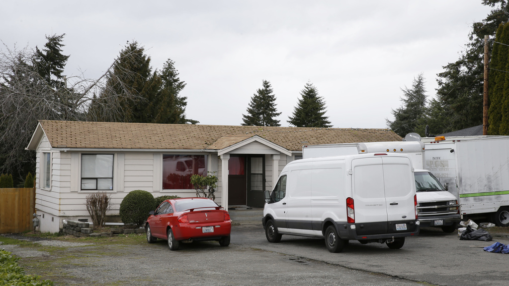 Vehicles sit parked Sunday, March 5, 2017, at the home and driveway where a Sikh man was shot in the arm Friday, March 3, 2017, in Kent...
