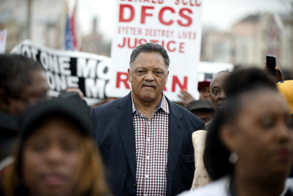 The Rev. Jesse Jackson walks with others during the annual re-enactment of a key event in the civil rights movement in Selma, Ala., Sun...