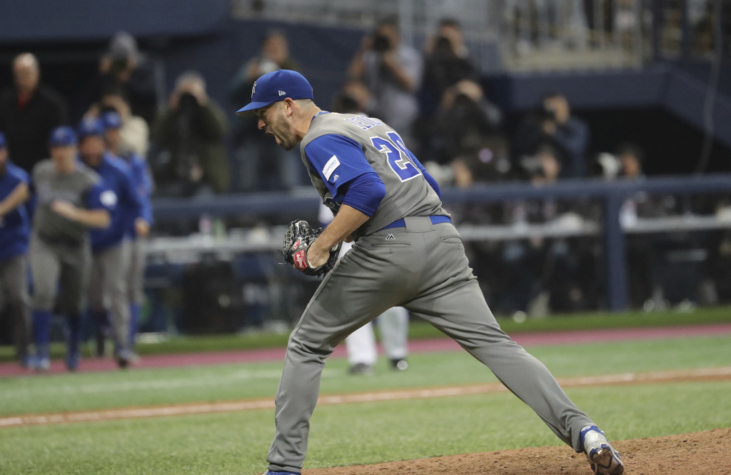 Israel's pitcher Josh Zeid celebrates his team's victory against South Korea after the first round game of the World Baseball Classic a...