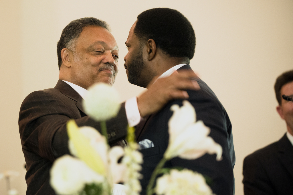The Rev. Jesse Jackson, left, embraces the Rev. Stephon Ferguson after reciting a Martin Luther King Jr. speech during a service at Bro...