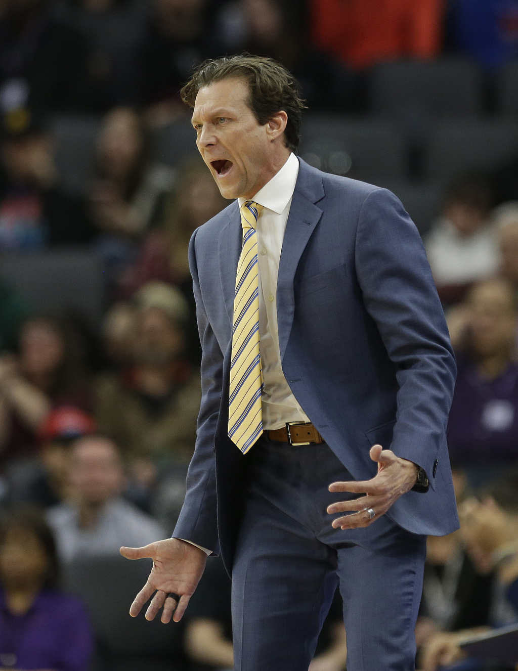 Utah Jazz head coach Quin Snyder calls out instructions to his team during the first half of an NBA basketball game against the Sacrame...