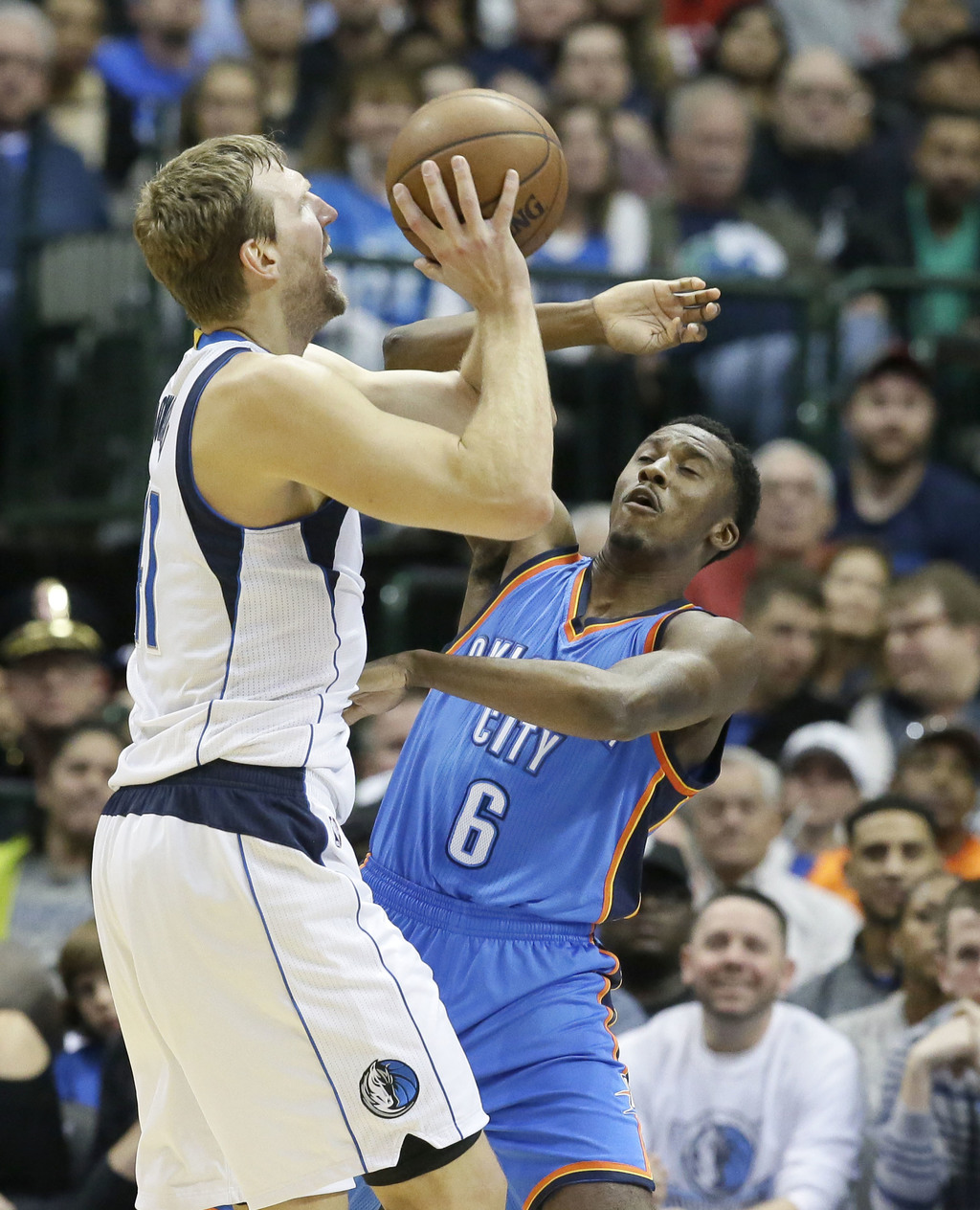 Dallas Mavericks forward Dirk Nowitzki (41) of Germany shoots against Oklahoma City Thunder guard Semaj Christon (6) during the first h...