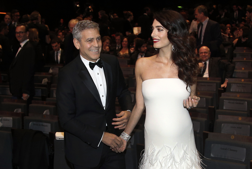 FILE - In this Feb. 24, 2017 file photo, actor George Clooney and his wife Amal Clooney arrive at the 42nd Cesar Film Awards ceremony i...