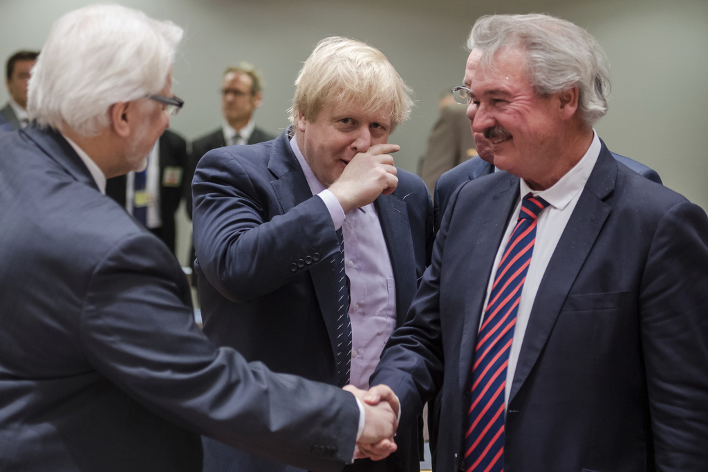 Britain's Foreign Secretary Boris Johnson, center, arrives as Luxembourg's Foreign Minister Jean Asselborn, right, greets Poland's Fore...