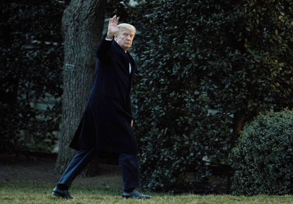 President Donald Trump waves as he arrives at the White House in Washington, Sunday, March 5, 2017, from a trip to Florida. (AP Photo/M...