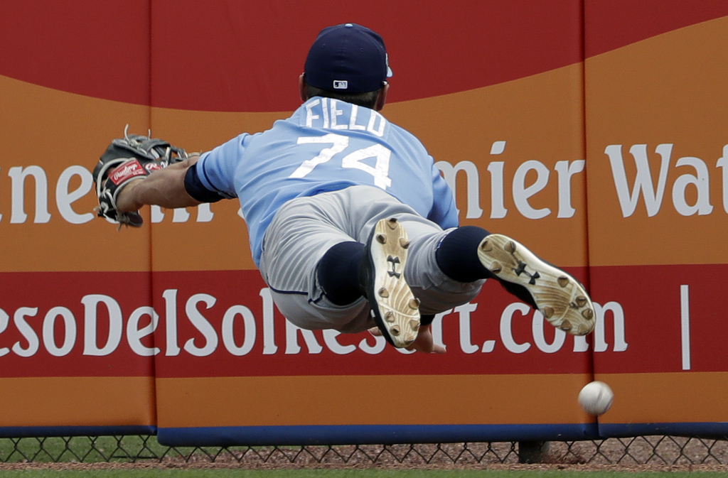 Tampa Bay Rays right fielder Johnny Field (74) dives for but cannot come up with a double by Toronto Blue Jays' Kevin Pillar during the...