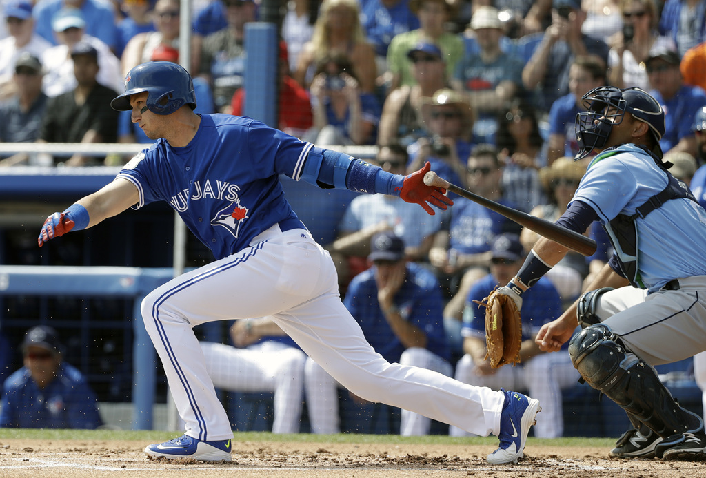 Toronto Blue Jays' Troy Tulowitzki bats in front of Tampa Bay Rays catcher Luke Maile during the first inning of a spring training base...