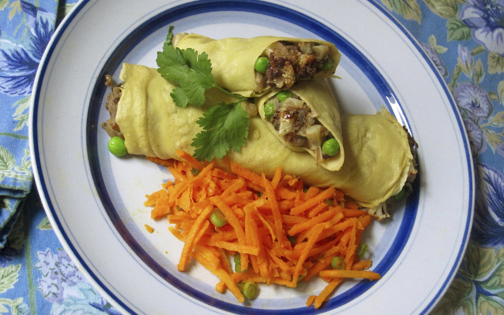 This February 2017 photo shows chickpea crepes stuffed with Indian spiced potatoes and peas in New York. This dish is from a recipe by ...