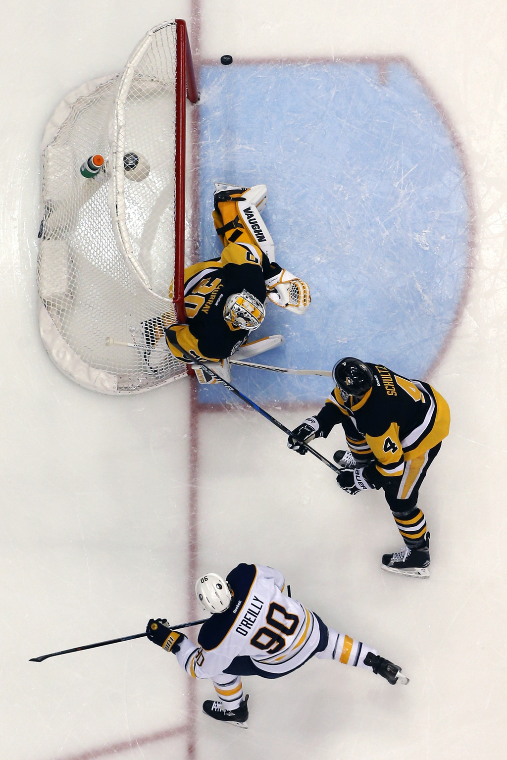 Buffalo Sabres' Ryan O'Reilly (90) lifts the puck over Pittsburgh Penguins goalie Matt Murray (30) for a goal with Justin Schultz (4) d...