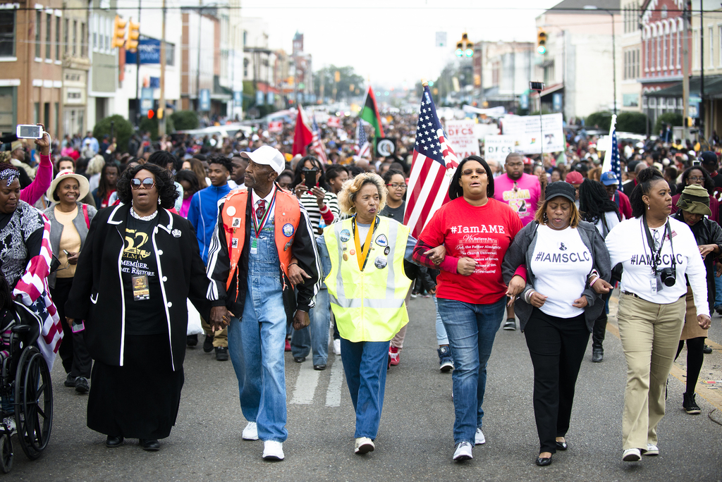 From left, Queen Jackson, John Rankin and others march during the annual re-enactment of a key event in the civil rights movement in Se...