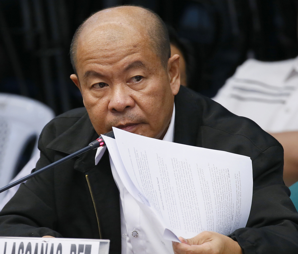 Retired police officer Arturo Lascanas holds documents as he testifies before a Senate inquiry Monday, March 6, 2017 in suburban Pasay ...